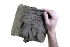 Craftsman, hand and clay Stock Photos