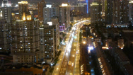 Stock Video Footage of time lapse busy urban traffic with streaking lights trail at night.