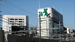 Railway and buildings in Shinjuku, Tokyo Stock Footage