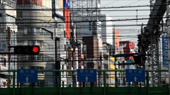 Train passing by with wiring and buildings in the background, Shinjuku, Tokyo - stock footage