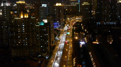 Busy urban traffic jam at night,Brightly lit urban morden building background. Stock Footage