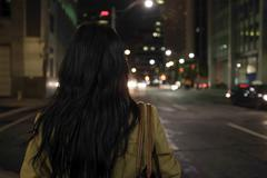 Woman standing at intersection Stock Photos