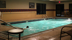 Hotel pool with 2 people swimming - stock footage
