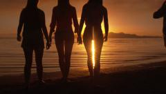 Group Of Five Girls Walking Up To The Water To Watch Sunset On The Beach Stock Footage