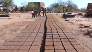 Stock Video Footage of Adobe Brick Making Far Dolly