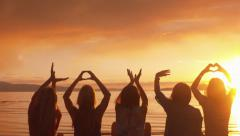 "Five Girls Spell ""Love,"" Make Heart w/Hands At Sunset On The Beach Stock Footage"