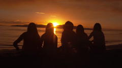 Group Of Five Girls Watching Sunset On The Beach Stock Footage