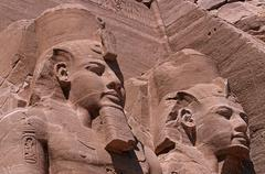 Egypt, Abu Simbel, Great Temple of Rameses II, two of the four statues of - stock photo