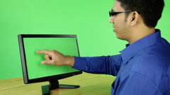 Angry frustrated business man with computer on green screen Stock Footage