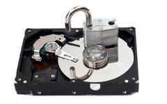 unlocked padlock on a hard disk drive - stock photo