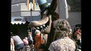 Stock Video Footage of Disneyworld 1980's: wolf character playing with visitor