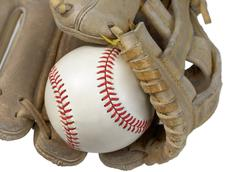 Closeup of hardball in baseball glove Stock Photos