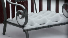 Heavy snow building up on a deck chair Stock Footage