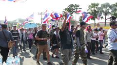 Protesters Towards Political Rally In Bangkok Thailand Carrying Flags - stock footage