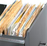 filing cabinet with files - stock photo