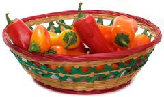 Multi colored bell peppers in basket Stock Photos