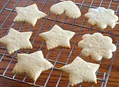 cutout cookies on a rack - stock photo