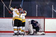 Stock Photo of Ice hockey competition, men: players embracing after the goal