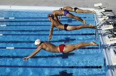 Swimmers starting a race - stock photo
