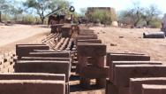 Stock Video Footage of Adobe Brick Making Stacked