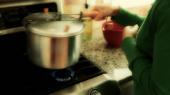 A woman making popcorn on the gas stove Stock Footage