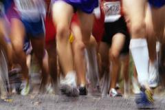 Stock Photo of Blurred action of runner's legs competing in a race