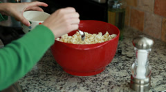 Woman making popcorn in the kitchen Stock Footage