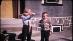Young fishermen show their catch to the camera, 698 vintage film home movie Stock Footage