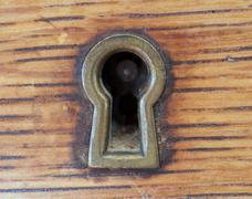 Antique key hole Stock Photos