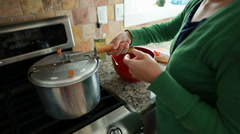 Woman cooking popcorn on a gas stove Stock Footage