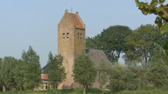 FRIESLAND, THE NETHERLANDS  Terp with 14th century Church of Westhem Stock Footage