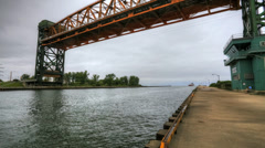 Timelapse of a lift bridge at a canal for lake freighters in Canada - stock footage
