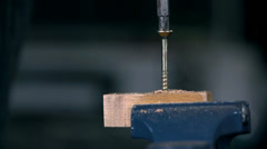 Screwing screw with electric drill in slow motion Stock Footage