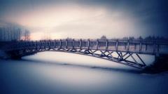 Snowflakes falling on an idyllic cozy bridge in winter, Reykjavik, Iceland Stock Footage