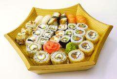 Stock Photo of Sushi set on a wooden plate