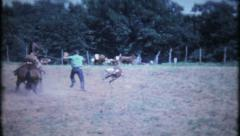 708 - cowboys compete in rodeo calf roping - vintage film home movie Stock Footage