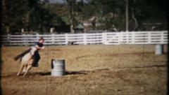 707 - young cowgirl competes in rodeo barrel racing - vintage film home movie - stock footage