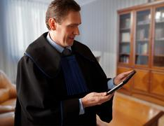 attorney with tablet - stock photo