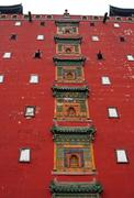 buddhist bass reliefs on the main wall of putuo zongcheng monastery in chengd - stock photo
