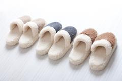 Natural woollen slippers Stock Photos