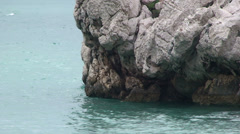 Calcareous karstic rock by the beach in Montenegro Stock Footage