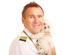 airline pilot with dog - stock photo