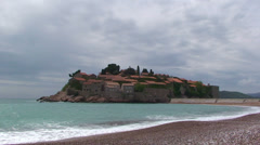 Sveti Stefan hotel island from the southern beach Stock Footage