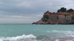 Southern side of Sveti Stefan from the beach Stock Footage