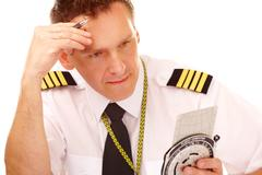 airline pilot using flight computer - stock photo