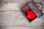 Stock Photo of red heart  in the old  box