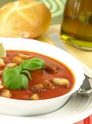 tomato soup with croutons and bread - stock photo