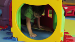Kid enjoys playing in a children playground Stock Footage