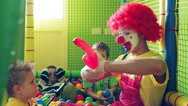 Stock Video Footage of Clown with balloon. Kids celebrating birthday party with clown