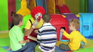 Stock Video Footage of Clown entertaining children at party